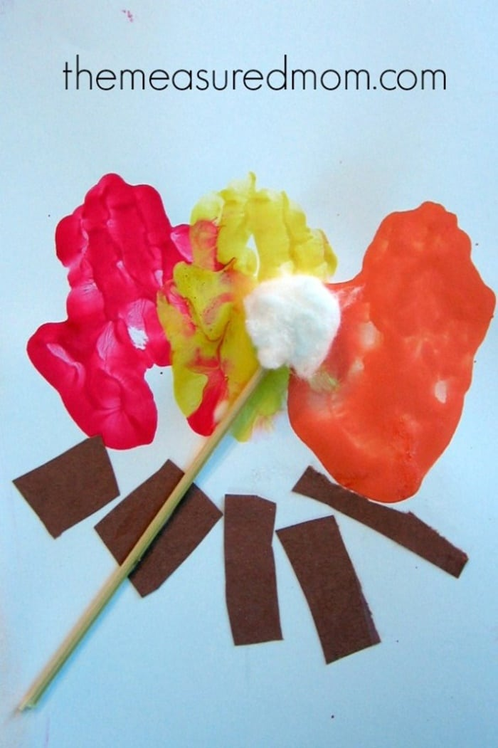 31 Easy and Fun Camping Theme Ideas and Activities - easy campfire handprint craft - Teach Junkie